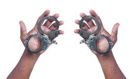 Hand holding handcuff Stock Image