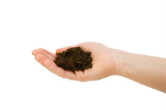 Hand holding handful of soil Royalty Free Stock Images