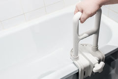 Hand holding the handrail in the bathroom Royalty Free Stock Image
