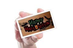 Hand holding happy Halloween party card or invitation Royalty Free Stock Photography