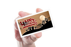 Hand holding happy Halloween and trick or treat card Royalty Free Stock Photography