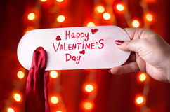 Hand holding Happy Valentines day card. Female hand holding Happy Valentines day card Royalty Free Stock Photos