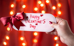 Hand holding Happy Valentines day card. Female hand holding Happy Valentines day card Royalty Free Stock Image