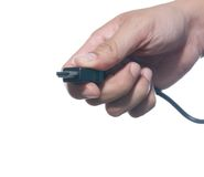 Hand holding hdmi cable Royalty Free Stock Photos