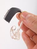 Hand holding hearing aid royalty free stock photos
