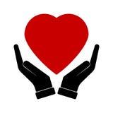 Hand holding heart healthcare Stock Photos