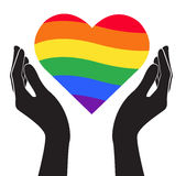 Hand holding heart rainbow flag LGBT symbol vector Stock Photos