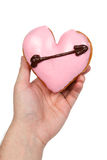 Hand Holding Heart Shaped Donut. Isolated on a White Background royalty free stock photography