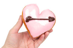 Hand Holding Heart Shaped Donut. Isolated on White Background royalty free stock photography