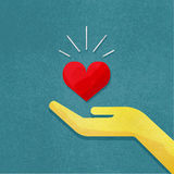 Hand holding heart. Vector illustration of human hand with red heart in it. Hand holding heart with rays of light. Grunge canvas background. Vintage illustration Royalty Free Stock Photo