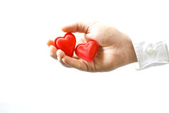 Hand holding hearts isolated / Valentine. Hand holding two small red hearts, isolated on white, with space for text Royalty Free Stock Images