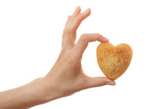 Hand holding heartshape cake Royalty Free Stock Images