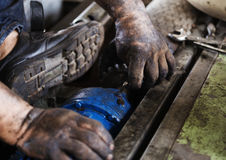 Hand holding hexagonal wrench and during maintenance work of ele Royalty Free Stock Photography