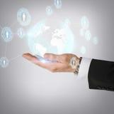 Hand holding hologram with globe Stock Photos