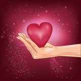 Hand holding a hot heart Stock Image