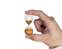 Hand holding hourglass Royalty Free Stock Photography