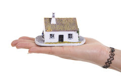 Hand holding house. A woman's hand holding a small house Stock Images