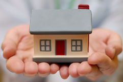 Hand holding house Royalty Free Stock Images
