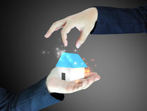 Hand holding house. Concept image of a hand holding house Stock Photography