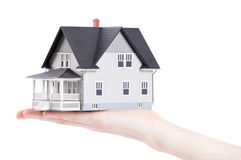 Hand holding house architectural model, isolated stock photo