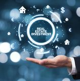 Hand holding house and currency symbols. Real Estate Investment royalty free stock images