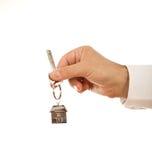 Hand holding house key Royalty Free Stock Photography