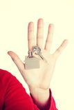 Hand holding a house key. Royalty Free Stock Photography