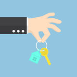 Hand holding a house key Stock Photography