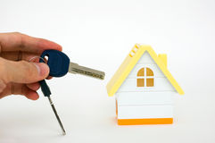Hand holding house keys Royalty Free Stock Images