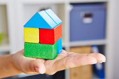 Hand holding house made of building blocks Royalty Free Stock Image