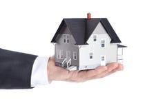 Hand holding house model, isolated Stock Image