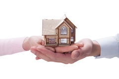 Hand holding house model Royalty Free Stock Photography