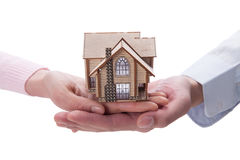 Hand holding house model Stock Photo