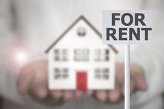 Hand holding house for rent Stock Images
