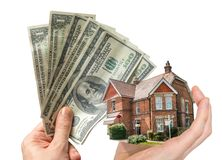 Hand holding house - sale of real estate. Hand holding house and money - sale of real estate Royalty Free Stock Images