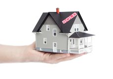 Hand holding household architectural model Royalty Free Stock Photography