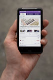 Hand holding HTC Desire HD showing Yahoo news Royalty Free Stock Photography
