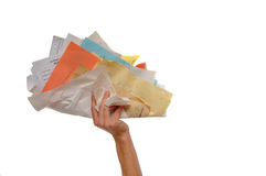 Hand holding huge wad of paper Royalty Free Stock Photo