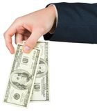 Hand holding hundred dollar bills Stock Photo