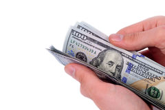 Hand holding hundred dollars on white background Royalty Free Stock Photography