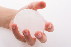 Hand holding an ice ball Royalty Free Stock Photo
