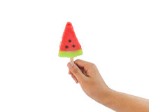 Hand holding ice cream watermelon shape isolated Stock Photo