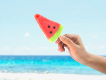 Hand holding ice cream watermelon shape Stock Image
