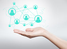 Hand holding icon, connection between users Stock Image