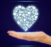 Hand Holding Icons in Medical Health Heart Shape Royalty Free Stock Photos