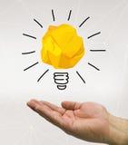 Hand holding an idea Stock Image