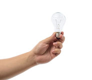 Hand holding an incandescent light bulb isolated on white backgr Royalty Free Stock Images