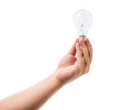 Hand holding an incandescent light bulb isolated on white backgr Stock Photos