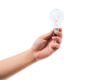 Hand holding an incandescent light bulb isolated on white backgr Stock Photography