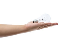 Hand holding an incandescent light bulb isolated on white backgr Stock Photo